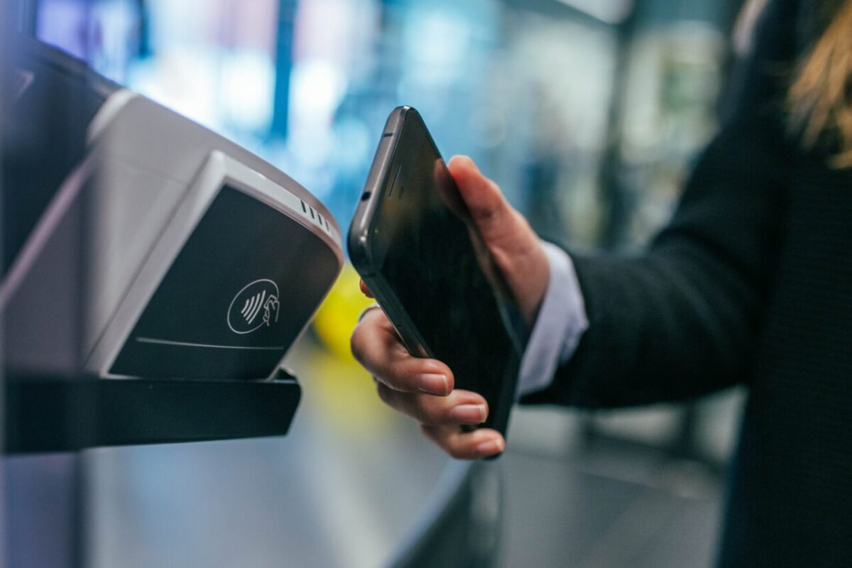 Person's hand making a contactless payment with their smartphone
